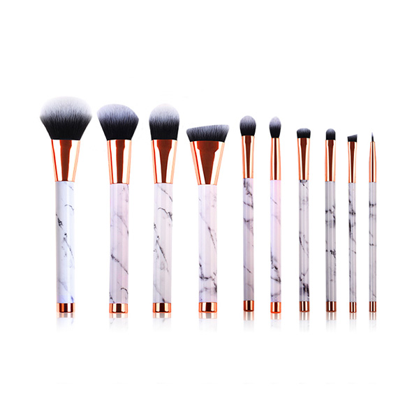 capped rose gold marble brush set